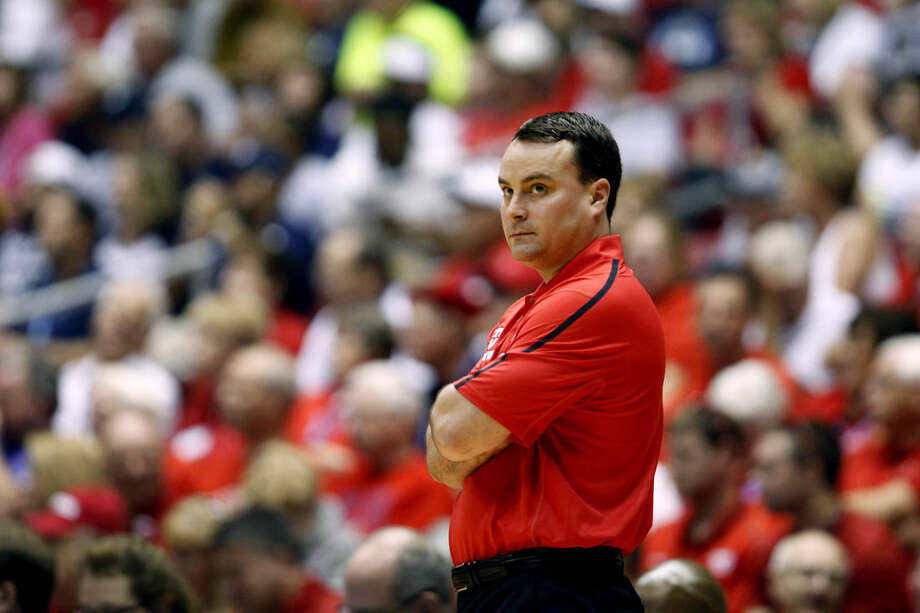 Dayton basketball coach Archie Miller looks on during the first half of an NCAA college basketball game against UConn in San Juan, Puerto Rico, Friday, Nov. 21, 2014. (AP Photo/Ricardo Arduengo)