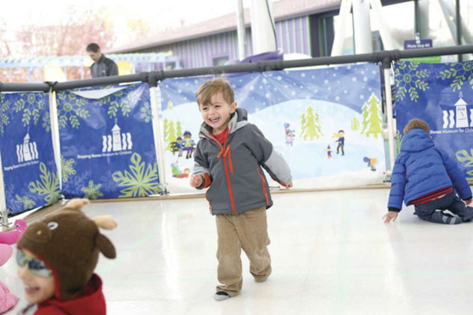 Ken Marks-Parrinello, 3, skates with his socks at Stepping Stones Museum in Norwalk Saturday afternoon.Hour Photo / Danielle Calloway
