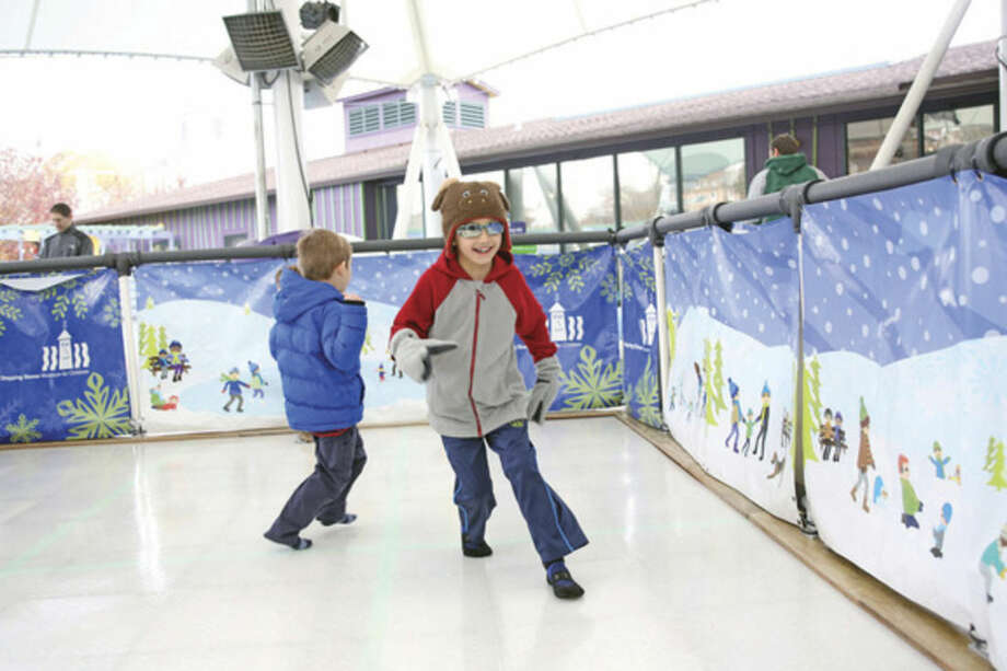 Samuel Giering, 6, skates with his socks at Stepping Stones Museum in Norwalk Saturday afternoon.Hour Photo / Danielle Calloway