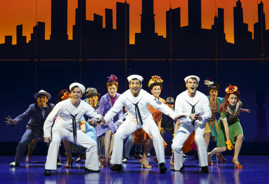 """FILE - In this undated file image released by Matt Ross Public Relations, Clyde Alves, front row from left, Tony Yazbeck and Jay Armstrong Johnson appear during a performance of """"On the Town,"""" in New York. More than two dozen cast members from the Broadway revival of """"On the Town"""" will be appearing on the Macy's Thanksgiving Day Parade route, adding a little razzle-dazzle amid the Snoopy and Buzz Lightyear balloons. In addition to """"On the Town,"""" shows to be spotlighted Thursday include """"A Gentleman's Guide to Love and Murder,"""" Sting's """"The Last Ship,"""" """"Side Show"""" and """"Finding Neverland."""" (AP Photo/Matt Ross Public Relations, Joan Marcus, File)"""
