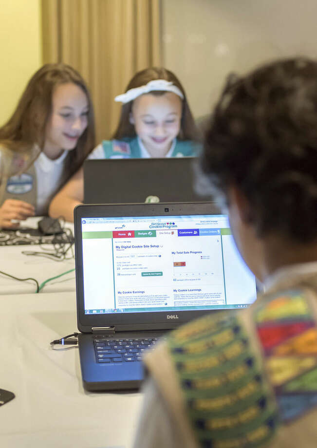 In this undated photo released from Girl Scouts of the USA, Girl Scouts Olivia and Isabella practice selling cookies on one of two new digital platforms. It's the first time Girls Scouts of the USA has allowed sale of cookies using a mobile app and personalized websites. The Digital Cookie program is intended to enhance, not replace, traditional use of paper spreadsheets. (AP Photo/Girl Scouts of the USA)
