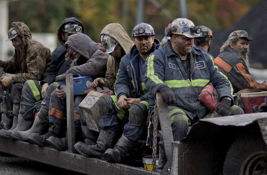 In this Oct. 15, 2014 photo, coal miners return on a buggy after working a shift underground at the Perkins Branch Coal Mine in Cumberland, Ky. As recently as the late 1970s, there were more than 350 mines operating at any given time in Harlan County. Today, it's around 40. (AP Photo/David Goldman)