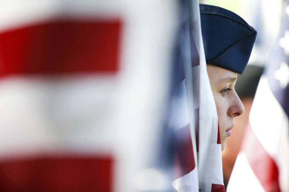 Hour photo/Chris PalermoNorwalk High School ROTC Cadet Shannon Huzina stands at rest during the Veteran of the Month Ceremony held at American Legion Post 12 Sunday morning.