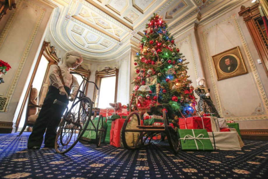 Hour photo / Chris Palermo. An 1890s depiction of typical Christmas decorations and gifts on display at Lockwood-Mathews Mansion for the museum's Grand Display of Holiday Traditions: Victorian Era Presents and Decorations.