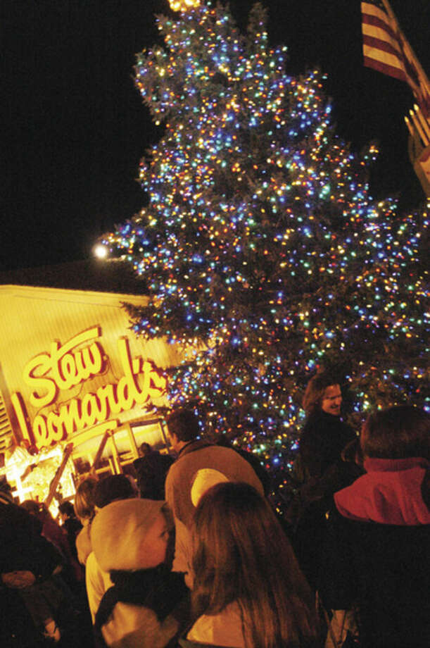 The Christmas tree lights up Tuesday night at the annual Stew Leonard's tree lighting/hour photo matthew vinci