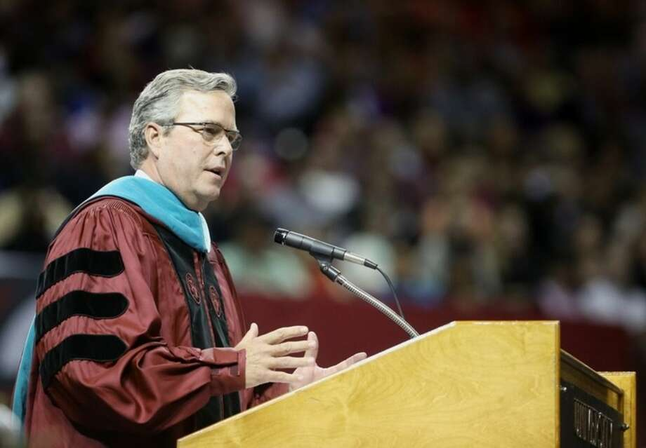 Former Florida Gov. Jeb Bush speaks at commencement exercises for The University of South Carolina in Columbia, S.C., on Monday, Dec. 15, 2014. It marks the Republican leader's second visit in three months to the state that will host the 2016 presidential primary season's first contest in the South. (AP Photo/The State, Tracy Glantz)
