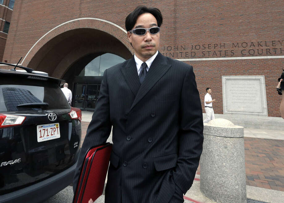FILE - In this Sept. 11, 2014 file photo, Glenn Adam Chin, former supervisory pharmacist at the New England Compounding Center, departs federal court in Boston. Chin was among 14 people from the pharmaceutical company arrested at their homes Wednesday, Dec. 17, 2014. Tainted steroids manufactured by the pharmacy were blamed for a fungal meningitis outbreak that killed 64 people across the country. (AP Photo/Steven Senne, File)