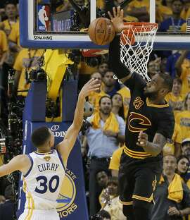 Cleveland Cavaliers' LeBron James blocks a Golden State Warriors' Stephen Curry shot in the second quarter during Game 5 of the NBA Finals at Oracle Arena on Monday, June 13, 2016 in Oakland, Calif.