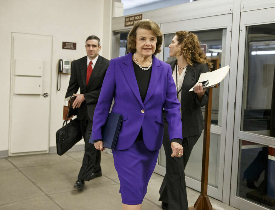Senate Intelligence Committee Chair Sen. Dianne Feinstein, D-Calif. arrives to release a report on the CIA's harsh interrogation techniques at secret overseas facilities after the 9/11 terror attacks, Tuesday, Dec. 9, 2014, on Capitol Hill in Washington. (AP Photo/J. Scott Applewhite)