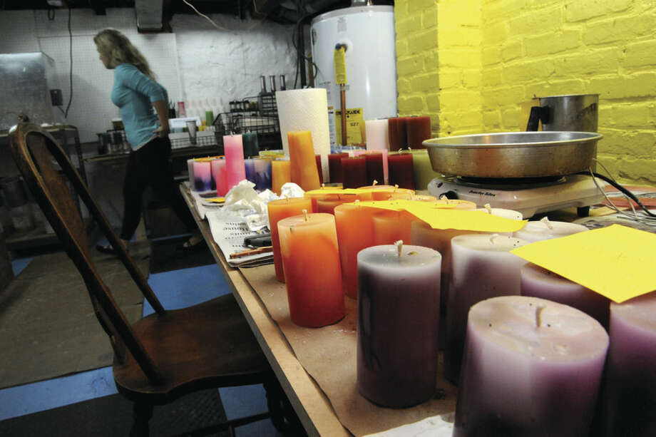 Candles in the workplace of Jenn Heatly, her at home buisness is Zen Moon Candles. Hour photo/Matthew Vinci