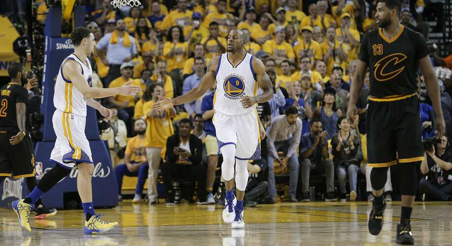 Golden State Warriors' Andre Iguodala celebrates with teammate Klay Thompson in the second quarter during Game 5 of the NBA Finals at Oracle Arena on Monday, June 13, 2016 in Oakland, Calif. Photo: Carlos Avila Gonzalez, The Chronicle