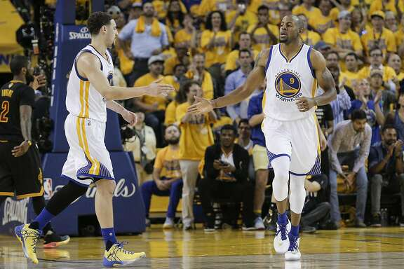 Golden State Warriors' Andre Iguodala celebrates with teammate Klay Thompson in the second quarter during Game 5 of the NBA Finals at Oracle Arena on Monday, June 13, 2016 in Oakland, Calif.