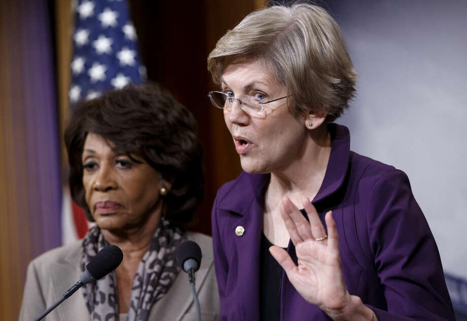 CORRECTS TO APPROVED, NOT PASSED - Sen. Elizabeth Warren, D-Mass., a member of the Senate Banking Committee, right, and Rep. Maxine Waters, D-Calif., ranking member of the House Financial Services Committee, express their outrage to reporters that a huge, $1.1 trillion spending bill approved by the Republican-controlled House yesterday contains changes to the 2010 Dodd-Frank law that regulates complex financial instruments known as derivatives, Wednesday, Dec. 10, 2014, on Capitol Hill in Washington. Democratic support for the omnibus bill funding every corner of government faded Wednesday as liberal lawmakers erupted over a provision that weakens the regulation of risky financial instruments and another that allows more money to flood into political parties. (AP Photo/J. Scott Applewhite)