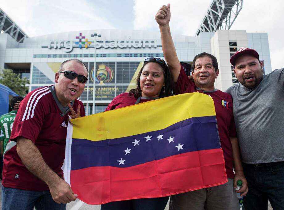 Venezuelan soccer fans, from left, Salvador Ibarra, Juana Duarte, Alberto Ibarra and Armando Duarte, pose for a photo as they arrive outside NRG Stadium before the Copa America match between Mexico and Venezuela on Monday. Photo: Brett Coomer, Staff / © 2016 Houston Chronicle