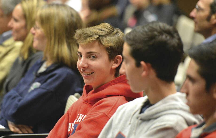 Hour Photo/Alex von Kleydorff Students and parents listen to Jack Renkens talk about recruiting