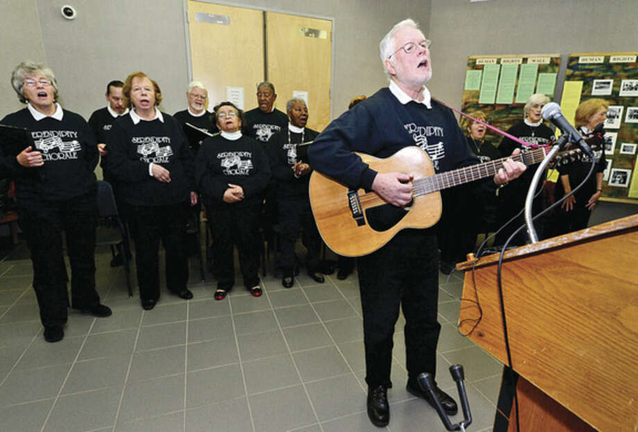 """Hour photo / Erik Trautmann Guitarist Bruce Taylor leads the Serendipity Chorale in the song """"We Shall Overcome"""" during the 23rd annual International Human Rights Day at Norwalk City Hall."""