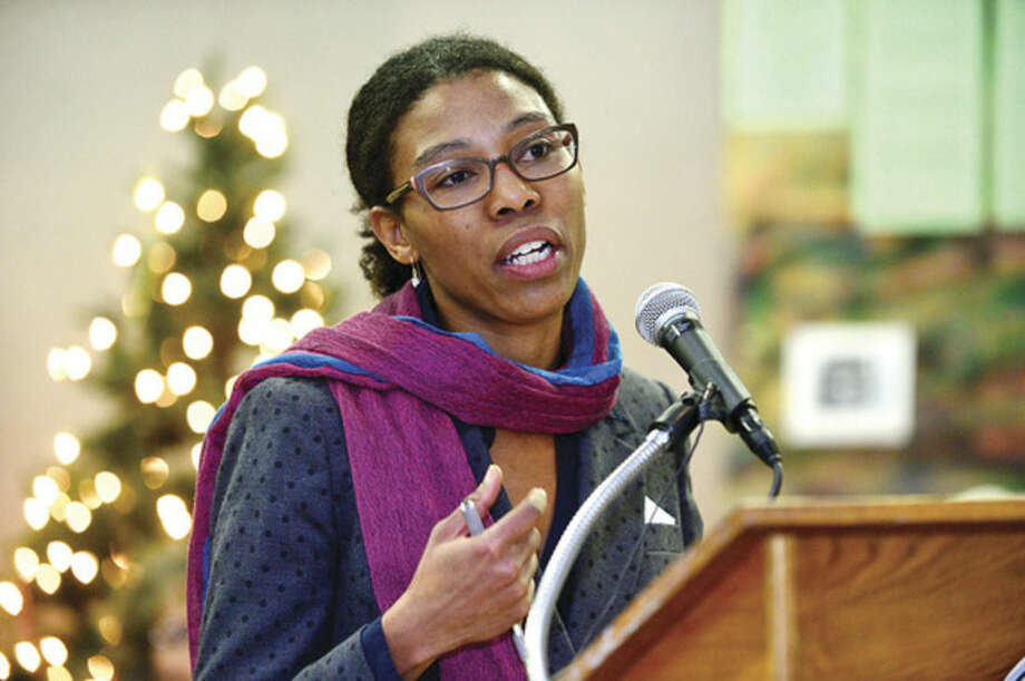 Hour photo / Erik Trautmann Associate Professor at Yale University, Dr. Crystal Feimster, gives her keynote address during the 23rd annual International Human Rights Day at Norwalk City Hall.