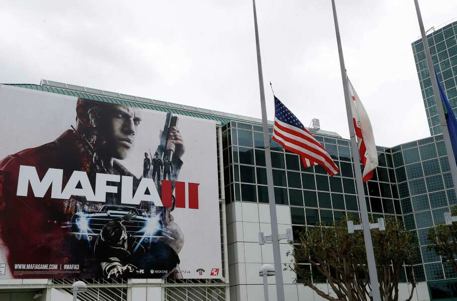 The E3 event in Los Angeles, where flags are being flown at half staff in honor of the victims of the Florida attack, started with presentations featuring footage of upcoming games - many of which depict unrelenting gun violence. Photo: Nick Ut, STF / Copyright 2016 The Associated Press. All rights reserved. This material may not be published, broadcast, rewritten or redistribu