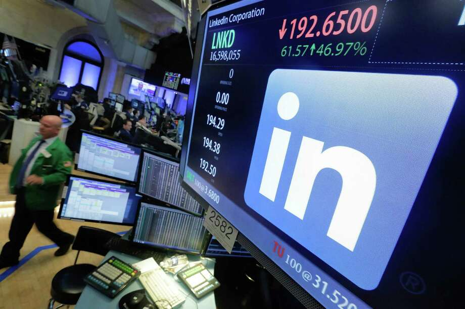 The LinkedIn logo appears Monday on a New York Stock Exchange screen. Its shares settled at $192.21, up 47 percent.  Photo: Richard Drew, STF / Copyright 2016 The Associated Press. All rights reserved. This material may not be published, broadcast, rewritten or redistribu