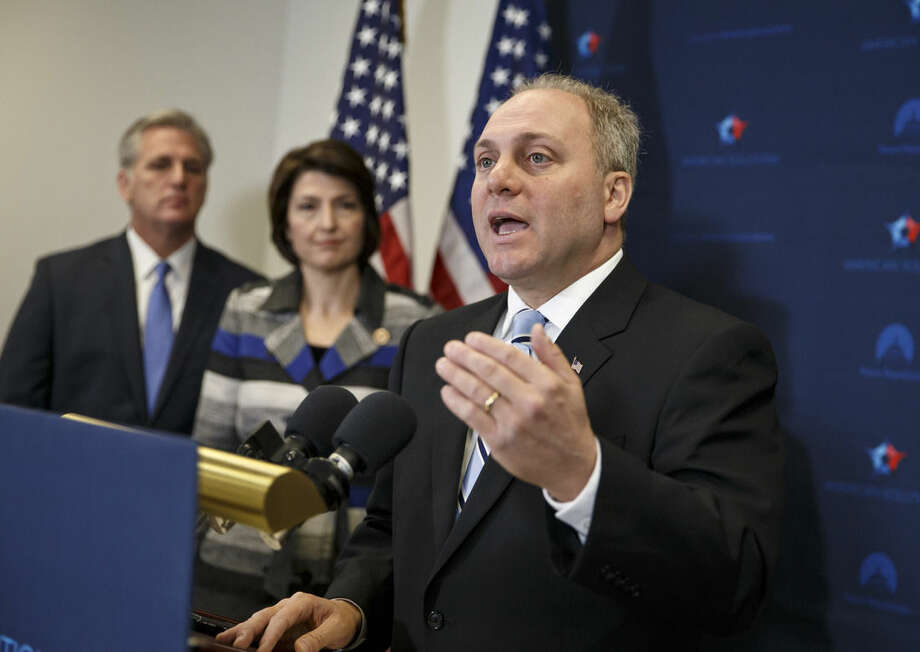 FILE - In this Nov. 18, 2014 file photo, House Majority Whip Steve Scalise of La., right, with House Majority Leader Kevin McCarthy of Calif., left, and Rep. Cathy McMorris Rodgers, R-Wash., speaks to reporters on Capitol Hill in Washington, following a House GOP caucus meeting. Scalise acknowledged that he once addressed a gathering of white supremacists. Scalise served in the Louisiana Legislature when he appeared at a 2002 convention of the European-American Unity and Rights Organization. Now he is the third-highest ranked House Republican in Washington. (AP Photo/J. Scott Applewhite, File)