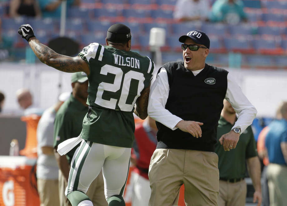 New York Jets cornerback Kyle Wilson (20) and New York Jets head coach Rex Ryan greet each other before an NFL football game against the Miami Dolphins, Sunday, Dec. 28, 2014, in Miami Gardens, Fla. (AP Photo/Lynne Sladky)