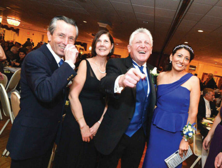 Hour Photo/Alex von KleydorffMayor Harry Rilling and now wife Lucia Cadena share some laughs with his sister Mary and brother in law Joe Bellavia at The 21st Annual Community Ball.