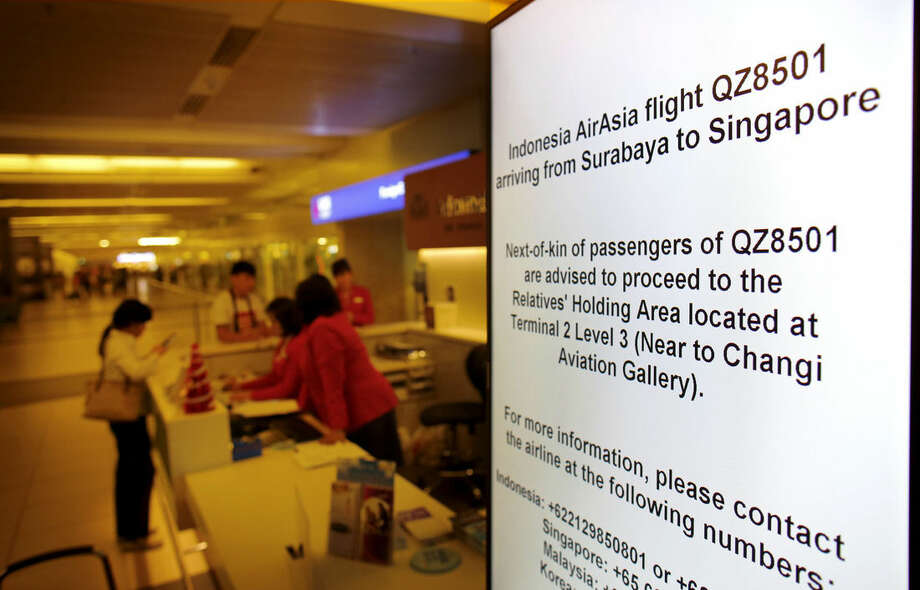 Electronic sign boards instructing relatives and next-of-kin to gather at a holding area are placed in various places at the Changi International Airport where AirAsia flight QZ8501 from Surabaya was scheduled to land, Sunday, Dec. 28, 2014 in Singapore. An AirAsia plane with 162 people on board lost contact with ground control on Sunday while flying over the Java Sea after taking off from a provincial city in Indonesia for Singapore. The two countries immediately launched a search and rescue operation but there was no word on the plane's whereabouts more than six hours after it went missing. (AP Photo/Wong Maye-E)