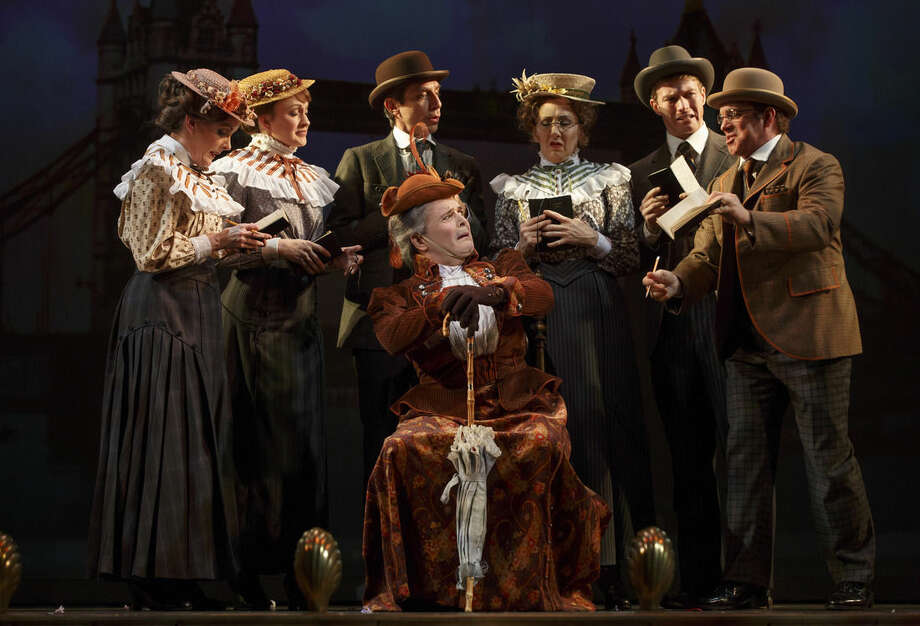 """This theater image released by The O+M Company shows Jefferson Mays , seated center, with the cast during a performance of """"A Gentleman's Guide to Love and Murder,"""" at the Walter Kerr Theatre in New York. (AP Photo/The O+M Company, Joan Marcus)"""