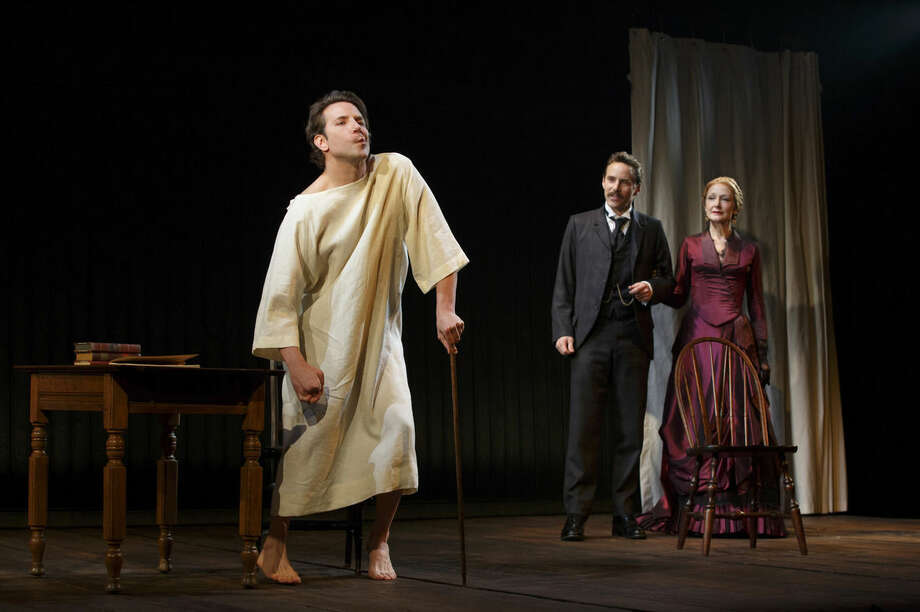 """This image released by Boneau/Bryan-Brown shows Bradley Cooper, from left, Alessandro Nivola, and Patricia Clarkson during a performance of """"The Elephant Man,"""" at the Booth Theatre in New York. (AP Photo/Boneau/Bryan-Brown, Joan Marcus)"""