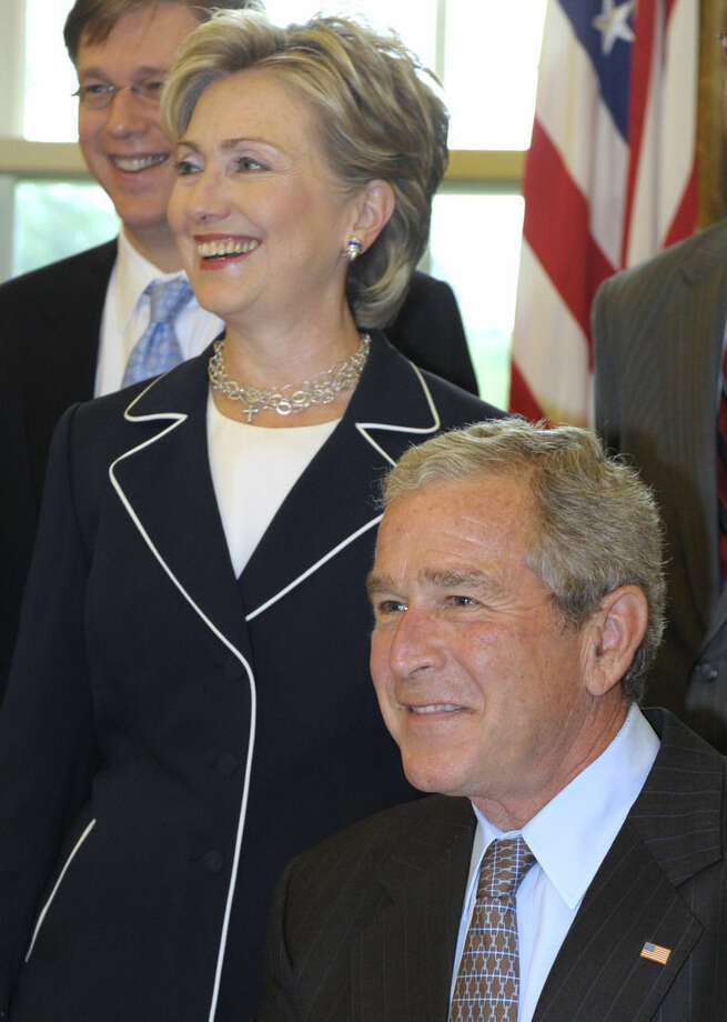 FILE - In this July 23, 2008 file photo, then-Sen. Hillary Rodham Clinton, D-N.Y. stands in the Oval Office of the White House in Washington with then President George W. Bush. Again? Really? There are more than 300 million people in America, yet the same two families keep popping up when it comes to picking a president. The possibility of a Bush-Clinton matchup in 2016 is increasingly plausible. After months of hints and speculation, former Florida Gov. Jeb Bush last week said he's actively exploring a bid for the Republican nomination. And while Hillary Rodham Clinton hasn't revealed her intentions, she's seen as the odds-on favorite for the Democratic nomination. (AP Photo/Evan Vucci, File)