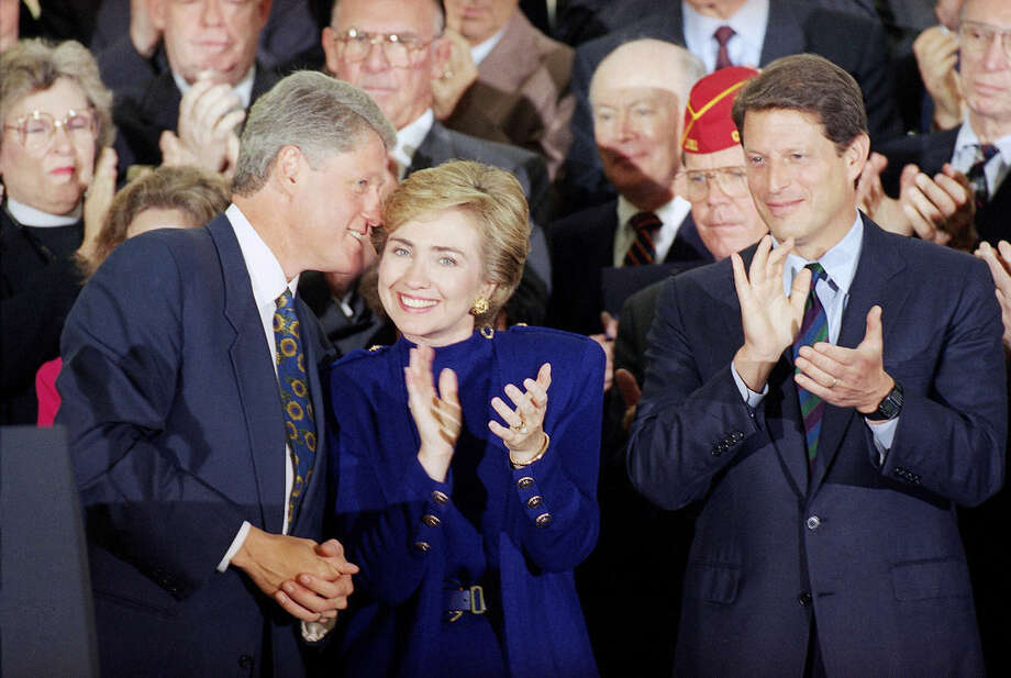 FILE - In this Sept. 23, 1993 file photo, then President Bill Clinton talks to his wife, then first lady Hillary Rodham Clinton as then Vice President Al Gore applauds during a kickoff prep rally for the president's health care plan at the White House. Again? Really? There are more than 300 million people in America, yet the same two families keep popping up when it comes to picking a president. The possibility of a Bush-Clinton matchup in 2016 is increasingly plausible. After months of hints and speculation, former Florida Gov. Jeb Bush last week said he's actively exploring a bid for the Republican nomination. And while Hillary Rodham Clinton hasn't revealed her intentions, she's seen as the odds-on favorite for the Democratic nomination. (AP Photo/Wilfredo Lee, File)