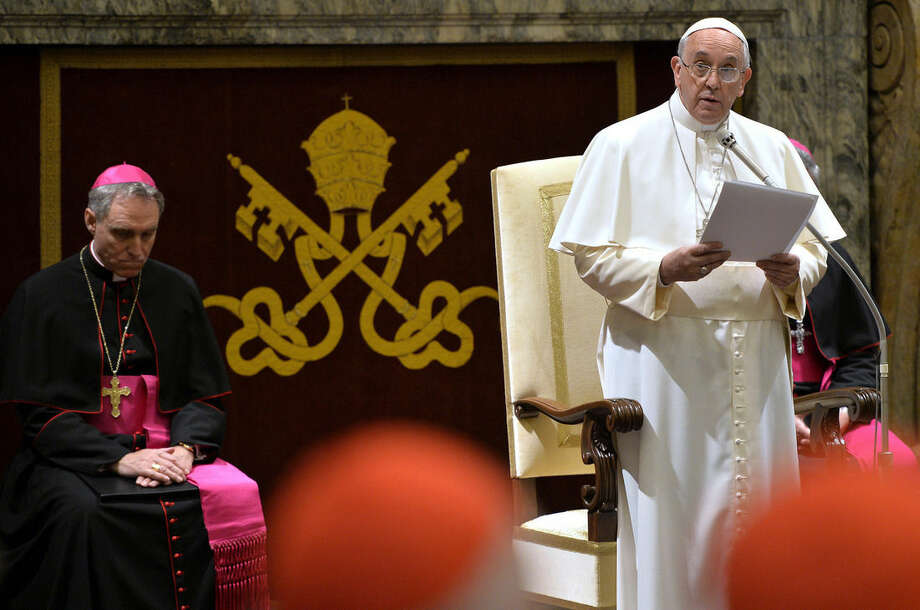 Pope Francis delivers his message during a meeting with Cardinals and Bishops of the Vatican Curia on the occasion of the exchange of Christmas greetings in the Clementine hall at Vatican, Monday, Dec. 22, 2014. (AP Photo/Andreas Solaro, Pool)