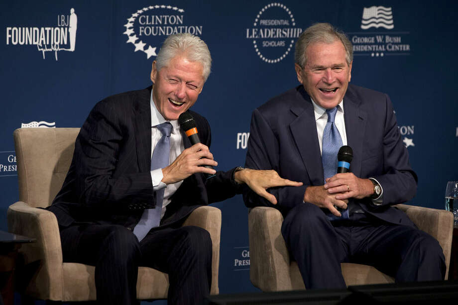 FILE - This Sept. 8, 2014, file photo shows former Presidents Bill Clinton, left, and George W. Bush, as they laugh together during the Presidential Leadership Scholars Program Launch, at The Newseum in Washington. Again? Really? There are more than 300 million people in America, yet the same two families keep popping up when it comes to picking a president. The possibility of a Bush-Clinton matchup in 2016 is increasingly plausible. After months of hints and speculation, former Florida Gov. Jeb Bush last week said he's actively exploring a bid for the Republican nomination. And while Hillary Rodham Clinton hasn't revealed her intentions, she's seen as the odds-on favorite for the Democratic nomination. (AP Photo/Jacquelyn Martin, File)