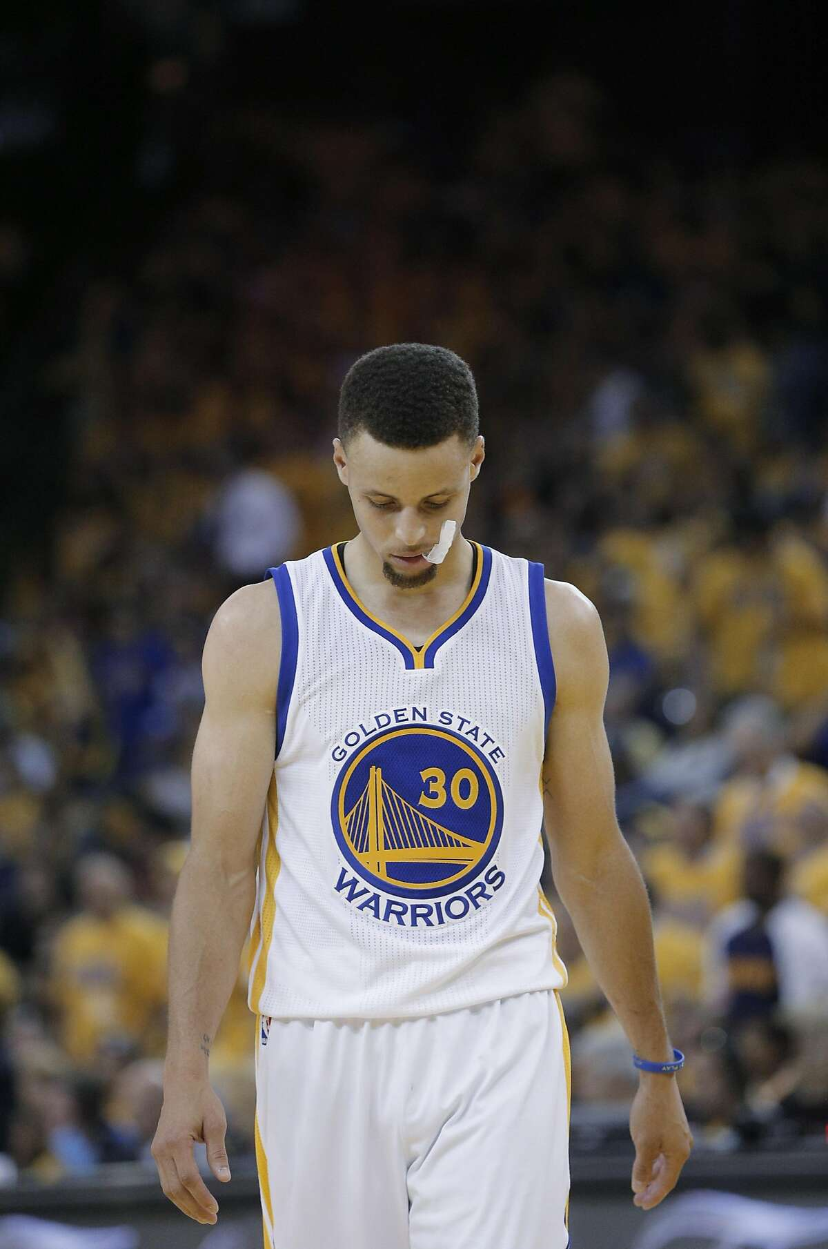 Stephen Curry (30) walks back up the court as the team trails in the fourth quarter as the Golden State Warriors played the Cleveland Cavaliers in Game 5 of the NBA Finals at Oracle Arena in Oakland, Calif., on Monday, June 13, 2016. The Cavaliers defeated the Warriors 112-97.