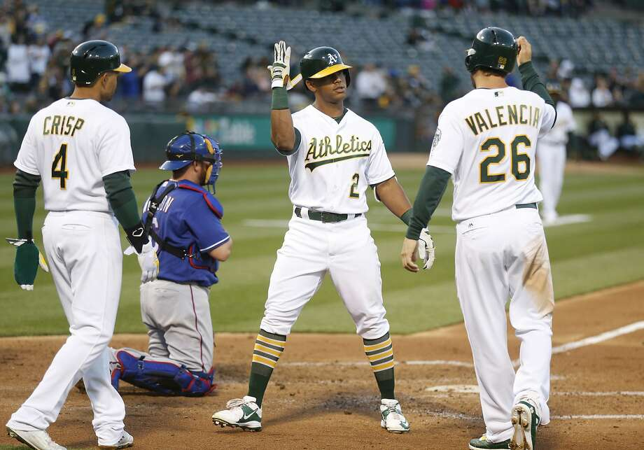 Khris Davis' three-run homer in the third inning was his first long ball since he hit one May 28 against Detroit. Photo: D. ROSS CAMERON, Associated Press