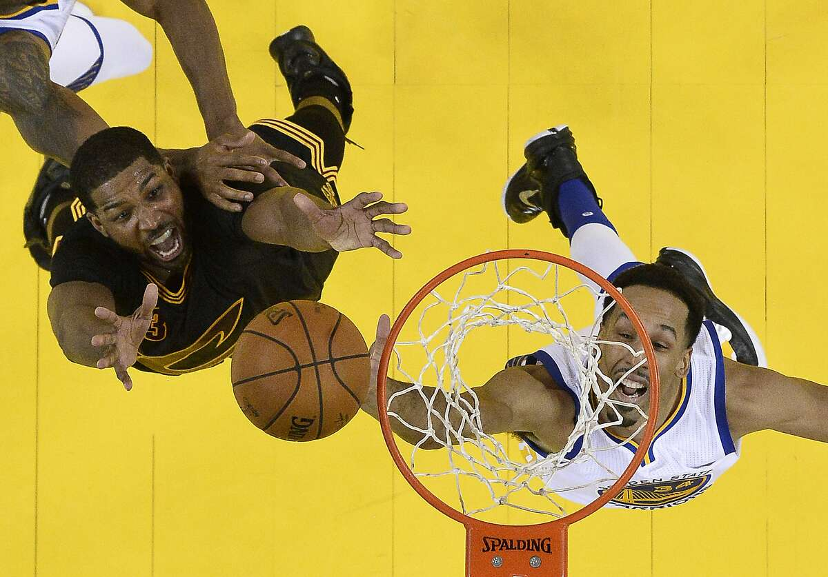 Cleveland Cavaliers center Tristan Thompson, left, and Golden State Warriors guard Shaun Livingston jump for a rebound during the second half of Game 5 of basketball's NBA Finals in Oakland, Calif., Monday, June 13, 2016. The Cavaliers won 112-97. (John G. Mabanglo, European Pressphoto Agency via AP, Pool)