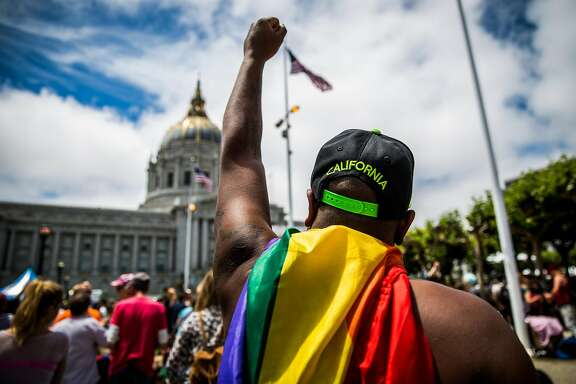 SAN FRANCISCO, CA- JUNE 28: Dwayne Edwards salutes City Hall after the San Francisco Gay Pride Parade, June 28, 2015 in San Francisco, California. The 2015 pride parade comes two days after the U.S. Supreme Court's landmark decision to legalize same-sex marriage in all 50 states. (Photo by Max Whittaker/Getty Images)