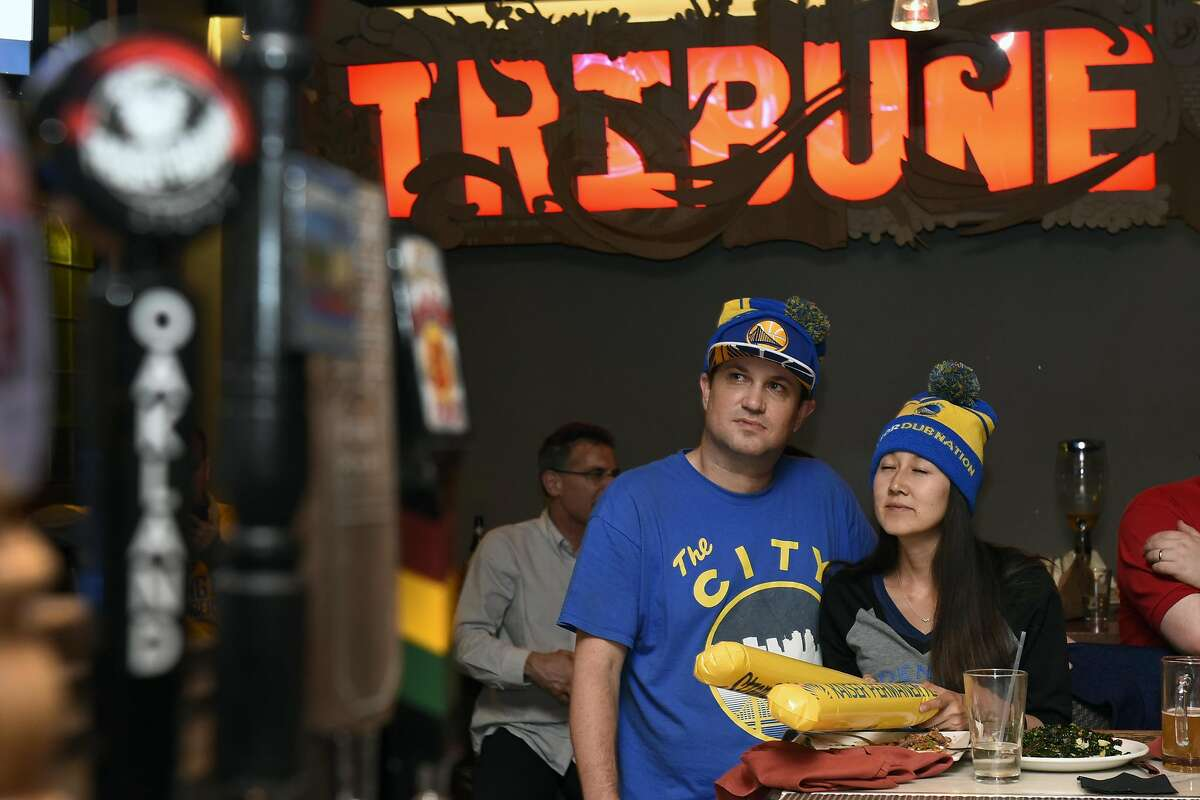 Daniel and Mindy Kleinsinger of Oakland, watch the final minutes of game five of the NBA championship between the Golden State Warriors and the Cleveland Cavaliers at the Tribune Tavern on Monday, June 13, 2016, in Oakland, Calif.