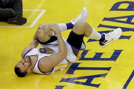 OAKLAND, CA - JUNE 13:  Andrew Bogut #12 of the Golden State Warriors holds his knee in pain after sustaining an injury during the third quarter against the Cleveland Cavaliers in Game 5 of the 2016 NBA Finals at ORACLE Arena on June 13, 2016 in Oakland, California. NOTE TO USER: User expressly acknowledges and agrees that, by downloading and or using this photograph, User is consenting to the terms and conditions of the Getty Images License Agreement.  (Photo by Ronald Martinez/Getty Images)