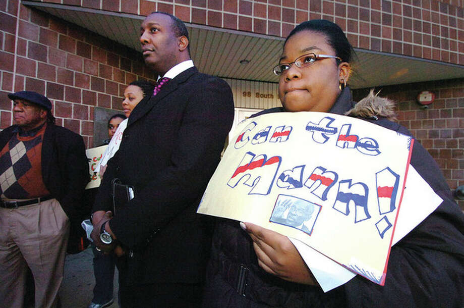 Hour photo / Alex von KleydorffA Headstart parent holds a sign at a rally this week asking that Joe Mann step down as director of NEON. On Thursday night parents and staff got their wish. / © 2012 The Hour Newspapers/Alex von Kleydorff