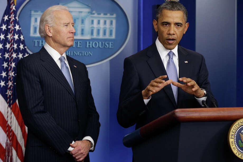 President Barack Obama and Vice President Joe Biden make a statement regarding the passage of the fiscal cliff bill in the Brady Press Briefing Room at the White House in Washington, Tuesday, Jan. 1, 2013. (AP Photo/Charles Dharapak) / AP