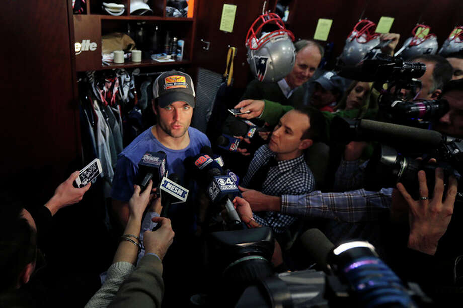 New England Patriots wide receiver Wes Welker is surrounded by members of the media in the locker room after an NFL football practice in Foxborough, Mass., Wednesday, Jan. 2, 2013. (AP Photo/Charles Krupa) / AP