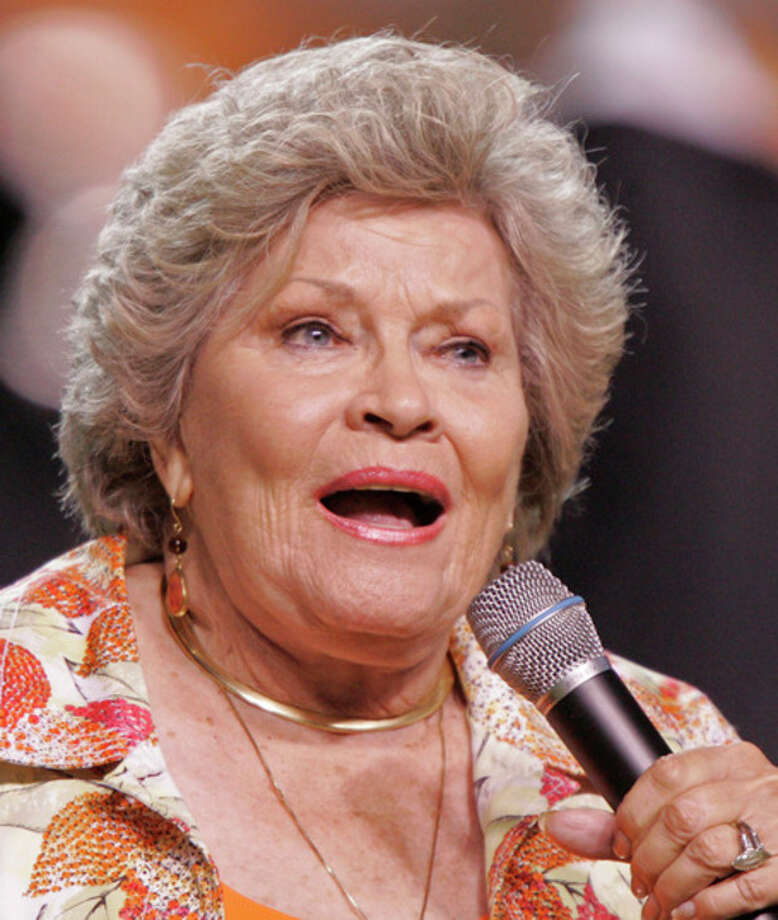 "FILE - In this Sept. 26, 2009 file photo, singer Patti Page performs the Tennessee Waltz during halftime of a NCAA college football game Tennessee and Ohio in Knoxville, Tenn. Page, who made ""Tennessee Waltz"" the third best-selling recording ever, has died. She was 85. (AP Photo/Wade Payne, file) / FR23601 AP"