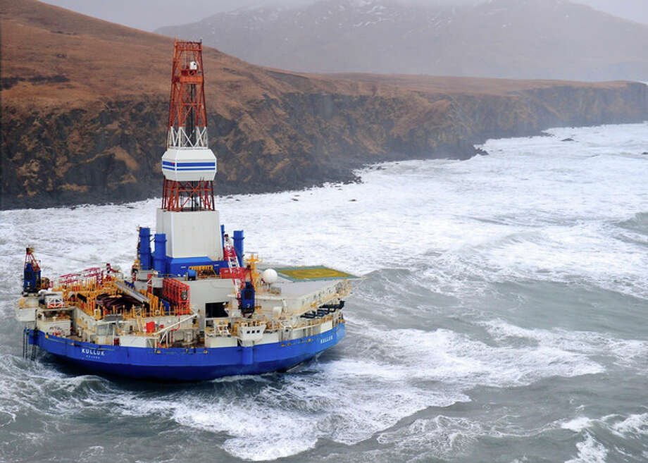 This aerial image provided by the U.S. Coast Guard shows the Royal Dutch Shell drilling rig Kulluk aground off a small island near Kodiak Island Tuesday, Jan. 1, 2013. No leak has been seen from the drilling ship that grounded off the island during a storm, officials said, as opponents criticized the growing race to explore the Arctic for energy resources. (AP Photo/U.S. Coast Guard) / US Coast Guard