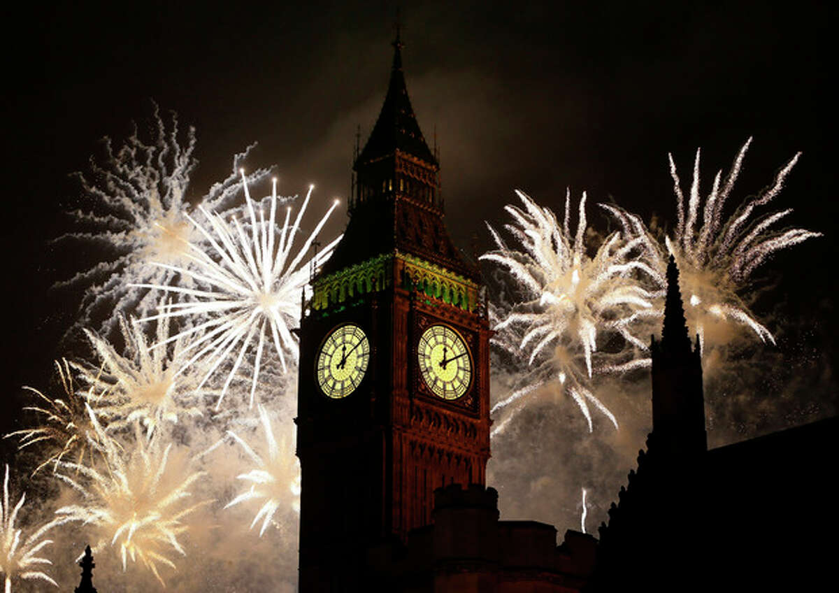 AP Photo/Kirsty Wigglesworth Fireworks explode over Elizabeth Tower housing the Big Ben clock to celebrate the New Year in London.