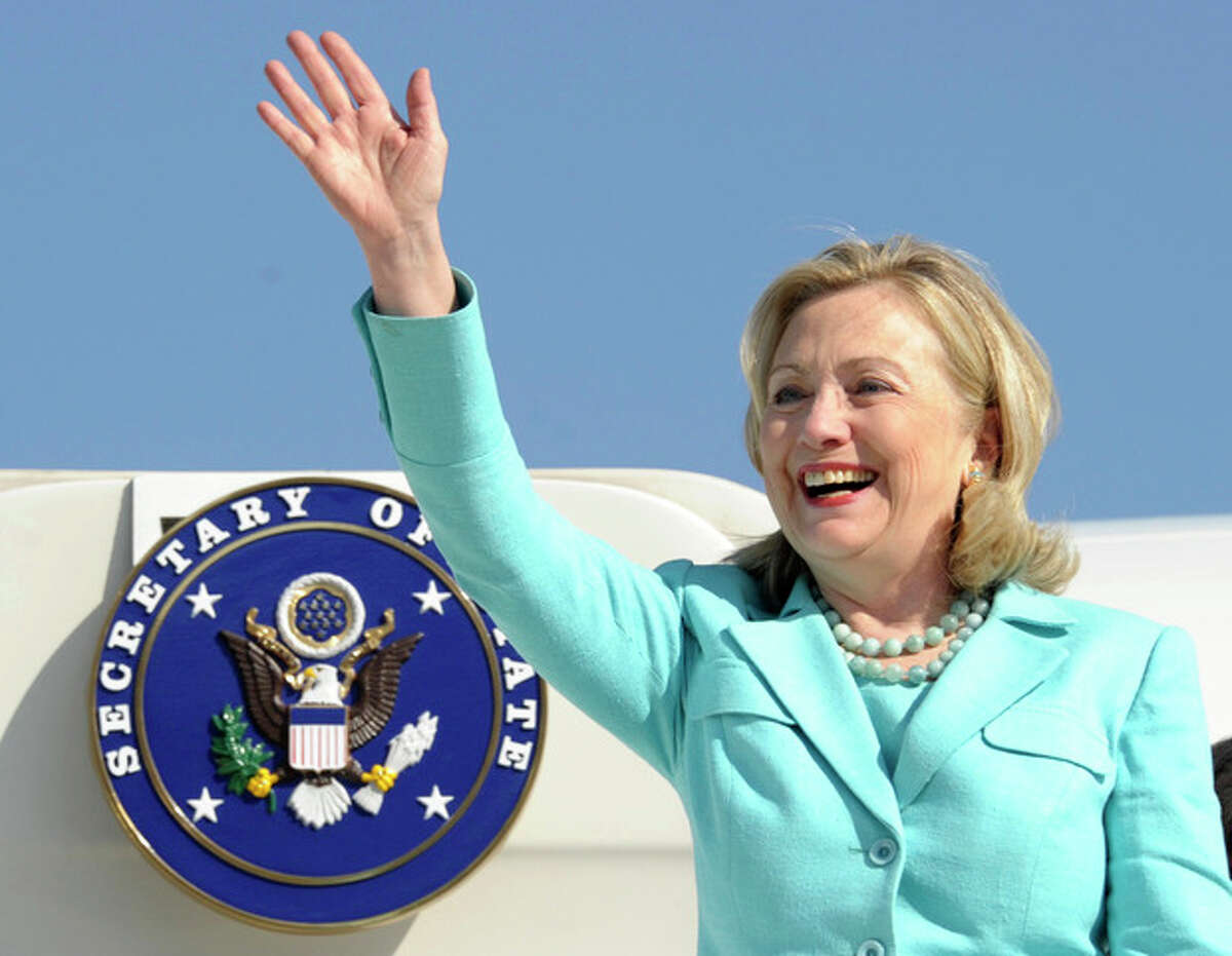 FILE - In this June 10, 2011 file photo, Secretary of State Hillary Rodham Clinton waves as the arrives at Lusaka International Airport in Lusaka, Zambia. Clinton has been admitted to a New York hospital after the discovery of a blood clot stemming from the concussion she sustained earlier this month. Spokesman Philippe Reines says her doctors discovered the clot during a follow-up exam Sunday, Dec. 30, 2012. (AP Photo/Susan Walsh, Pool, File)