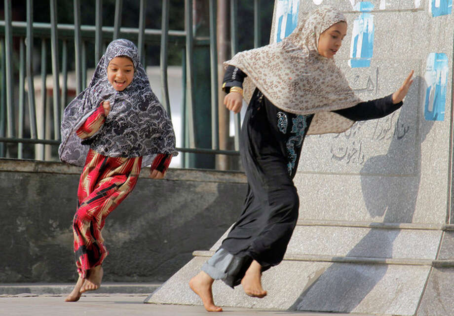 The New Year's day holiday brings Egyptian children out to play on the street in the affluent neighborhood of Zamalek, Cairo, Egypt, Tuesday, Jan. 1, 2013. (AP Photo/Amr Nabil) / AP