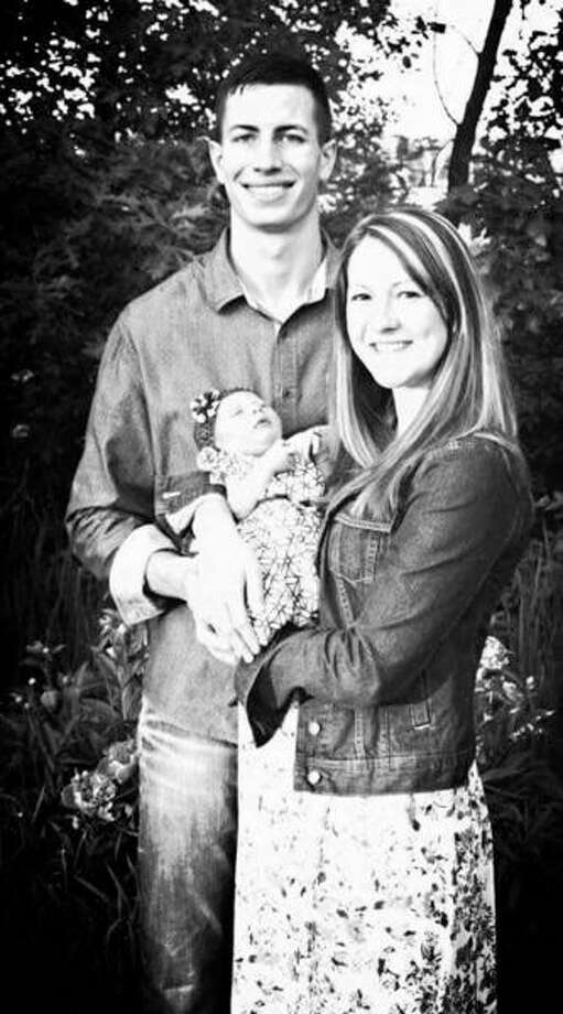 Photo provided  Dr. Ryan Balzer is opening ADIO Chiropractic at 301 E. Wackerly St. in the Bell Plaza. Balzer is shown with his wife, Elizabeth, and their newborn daughter, Olivia. The practice will treat the entire family.