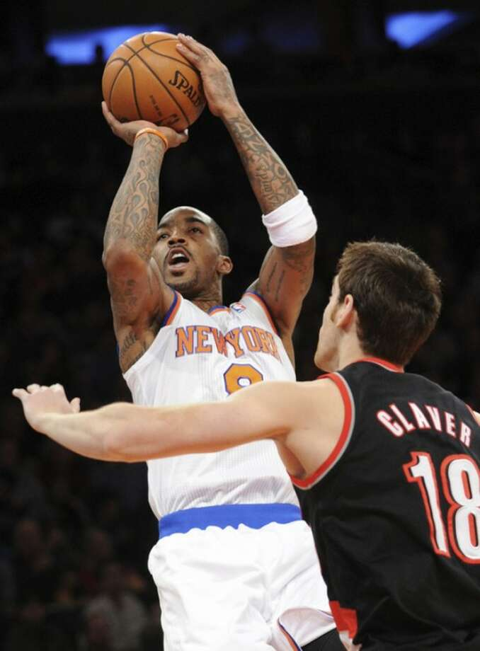 New York Knicks' J.R. Smith shoots over Portland Trail Blazers' Victor Claver (18), of Spain, during the second quarter of an NBA basketball game, Tuesday, Jan. 1, 2013, at Madison Square Garden in New York. (AP Photo/Bill Kostroun)