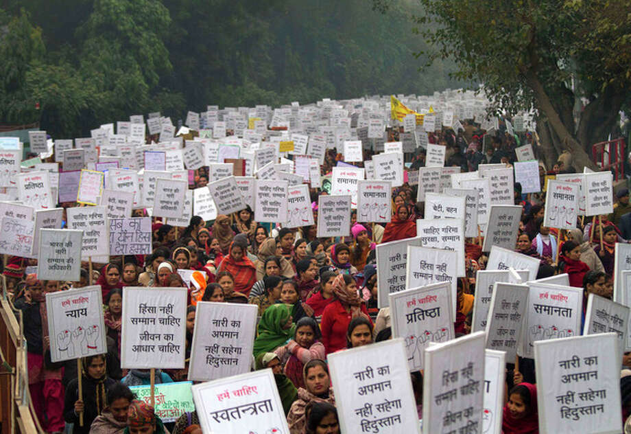 """Indian women carry placards as they march to mourn the death of a gang rape victim in New Delhi, India, Wednesday, Jan. 2, 2013. India's top court says it will decide whether to suspend lawmakers facing sexual assault charges as thousands of women gathered at the memorial to independence leader Mohandas K. Gandhi to demand stronger protection for their safety. The banners read """"India won't tolerate women's insult and We want respect not violence in life."""" (AP Photo/ Dar Yasin) / AP"""